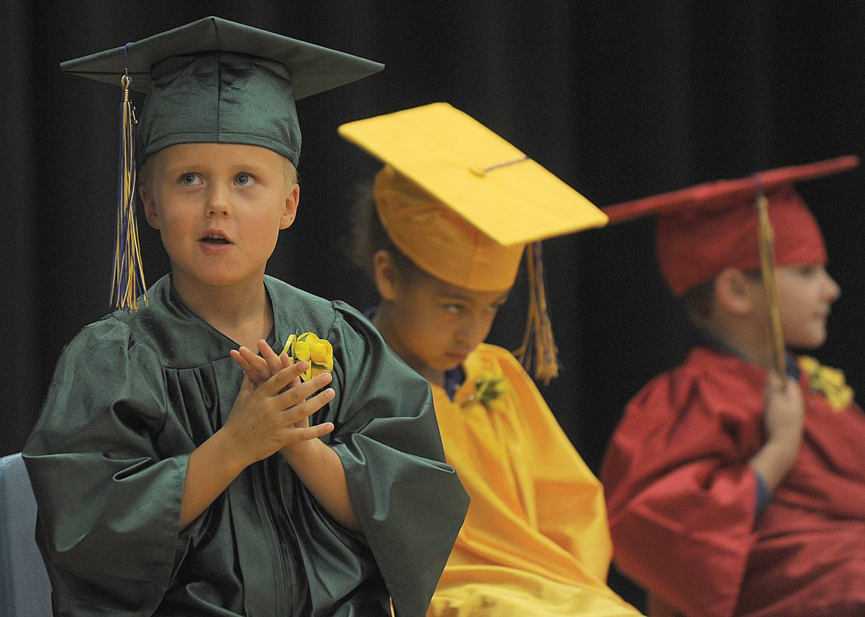Kindergartner Marshall Moss waits to hear his name called during the Heritage Christian School kindergarten graduation Tuesday afternoon at the school west of Steamboat Springs. Eleven students graduated and will move onto first grade next year.