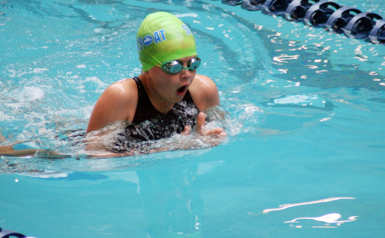 Kendall Harrington, 10, swims the breast stroke last weekend in a swim meet on the Front Range. The Steamboat Springs Swim Team brought home a heap of top finishes from the event.