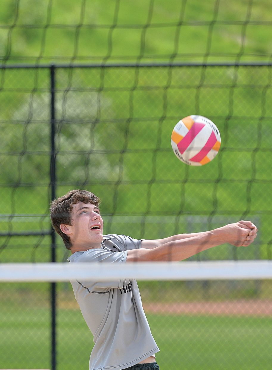 Jesse Kennedy returns a shot while playing volleyball with his family at Howelsen Beach Wednesday afternoon. The Kennedys were visiting Steamboat Springs from Missouri.