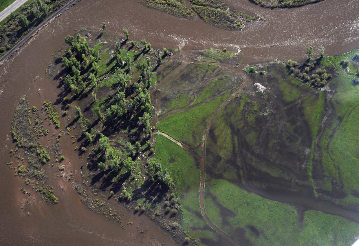 The waters of the Yampa River had ran over river banks and flooded wetlands areas between Steamboat Springs and Hayden. However, Routt County of Emergency Management director, Bob Struble said that both the Yampa and Elk rivers are doing a good job of handling spring runoff. On Tuesday both rivers were below flood stage. Struble is optimistic the flooding will be isolated and that private structures will not be threatens, but added that he will have to wait and see what the next few days bring.