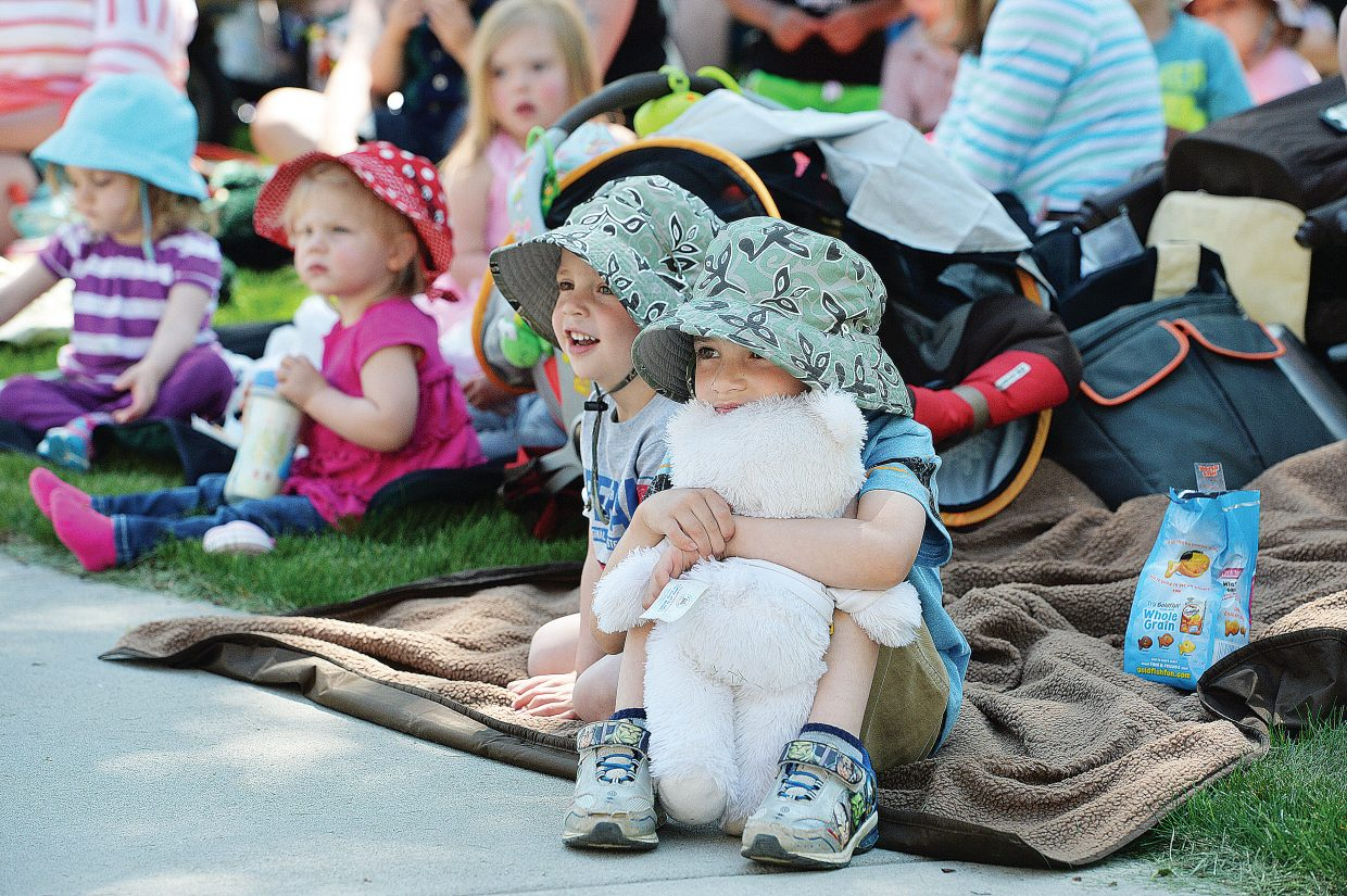 Five-year-old Ryan Becker hugs his teddy bear during the annual Teddy Bear Picnic at the Bud Werner Memorial Library Thursday morning. The event included entertainment from the Yampa Valley Boys and We're Not Clowns, as well as face painting. For more photos from the event, visit SteamboatToday.com.