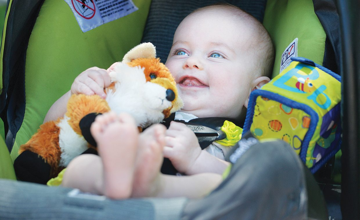 Four-month old Joey Lynn enjoys her first Teddy Bear Picnic at the Bud Werner Memorial Library Thursday morning. The event included entertainment from the Yampa Valley Boys and We're Not Clowns as well as face painting.