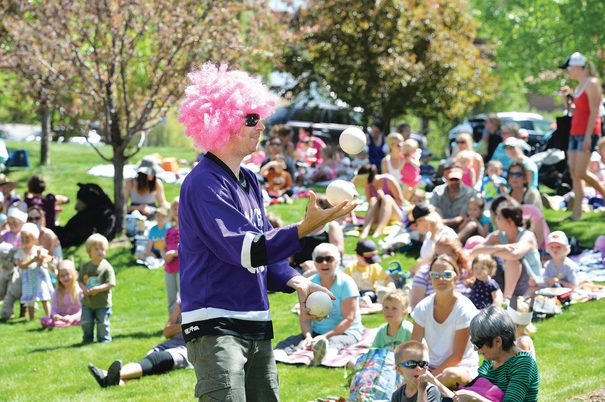Kelly Anzalone, from We're Not Clowns, juggles during the annual Teddy Bear Picnic at the Bud Werner Memorial Library Thursday morning. The event included entertainment from the Yampa Valley Boys and We're Not Clowns as well as face painting.
