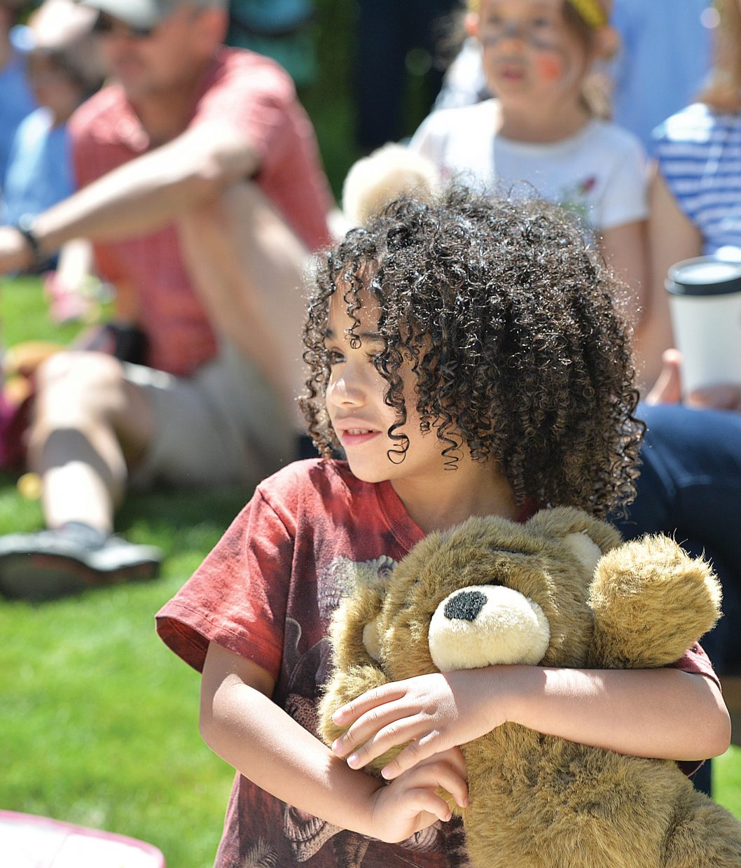 Three-year-old Enzo Ciraldo-Thomas hugs his teddy bear during the annual Teddy Bear Picnic at the Bud Werner Memorial Library Thursday morning. The event included entertainment from the Yampa Valley Boys and We're Not Clowns as well as face painting.