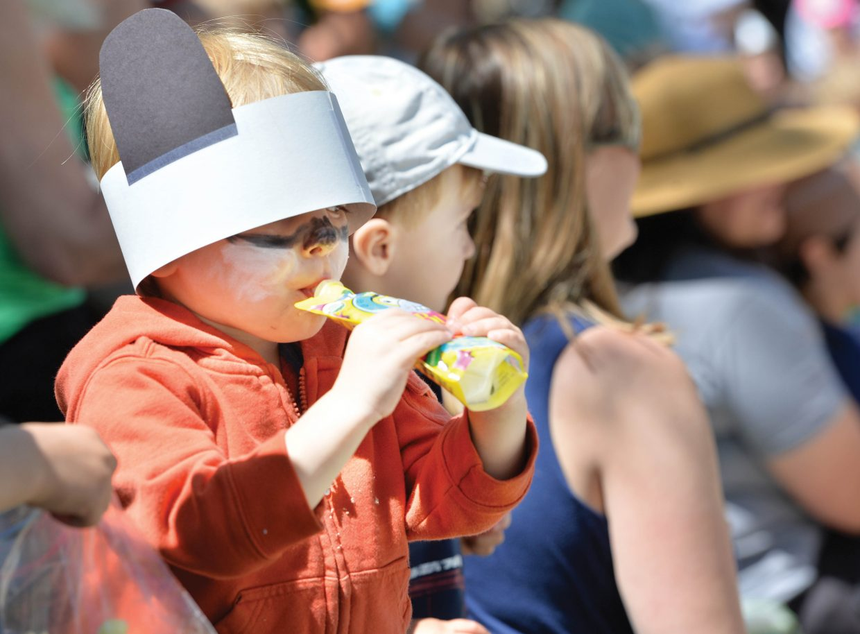 Charlie Wright enjoys a juice pouch at the annual Teddy Bear Picnic at the Bud Werner Memorial Library Thursday morning. The event included entertainment from the Yampa Valley Boys and We're Not Clowns as well as face painting.