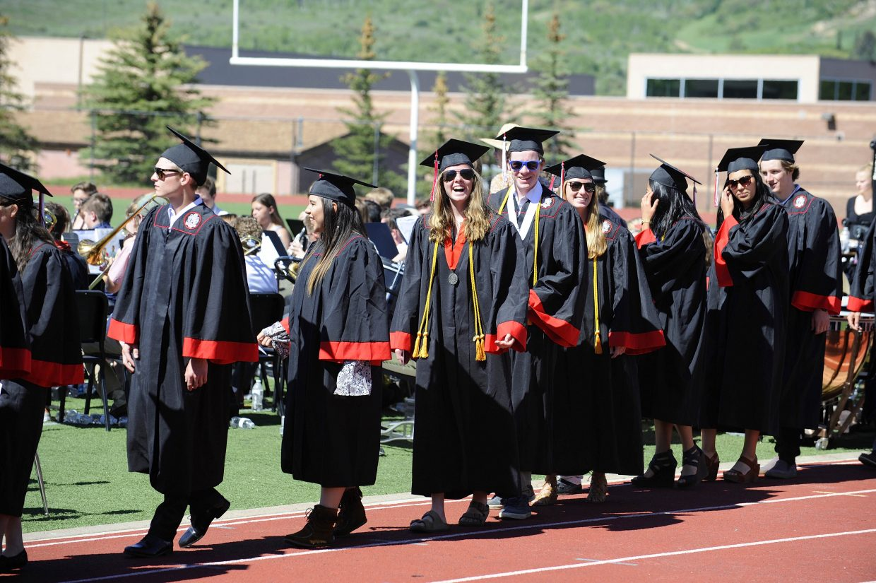 Students march onto Gardner Field for Saturday's Steamboat Springs High School graduation.
