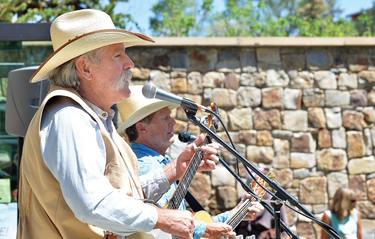 John Fisher, front, and Steve Jones play music during the annual Teddy Bear Picnic at the Bud Werner Memorial Library Thursday afternoon. The annual lunch has become a tradition for lots of local families in Steamboat Springs who come out for music and lunch on the lawn.