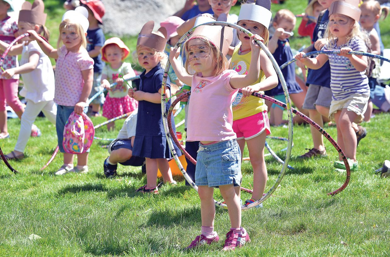 Emily Townsend holds a Hula-Hoops while she listens to music at the annual Teddy Bear Picnic at the Bud Werner Memorial Library Thursday afternoon. The annual lunch has become a tradition for lots of local families in Steamboat Springs who come out for music and lunch on the lawn.