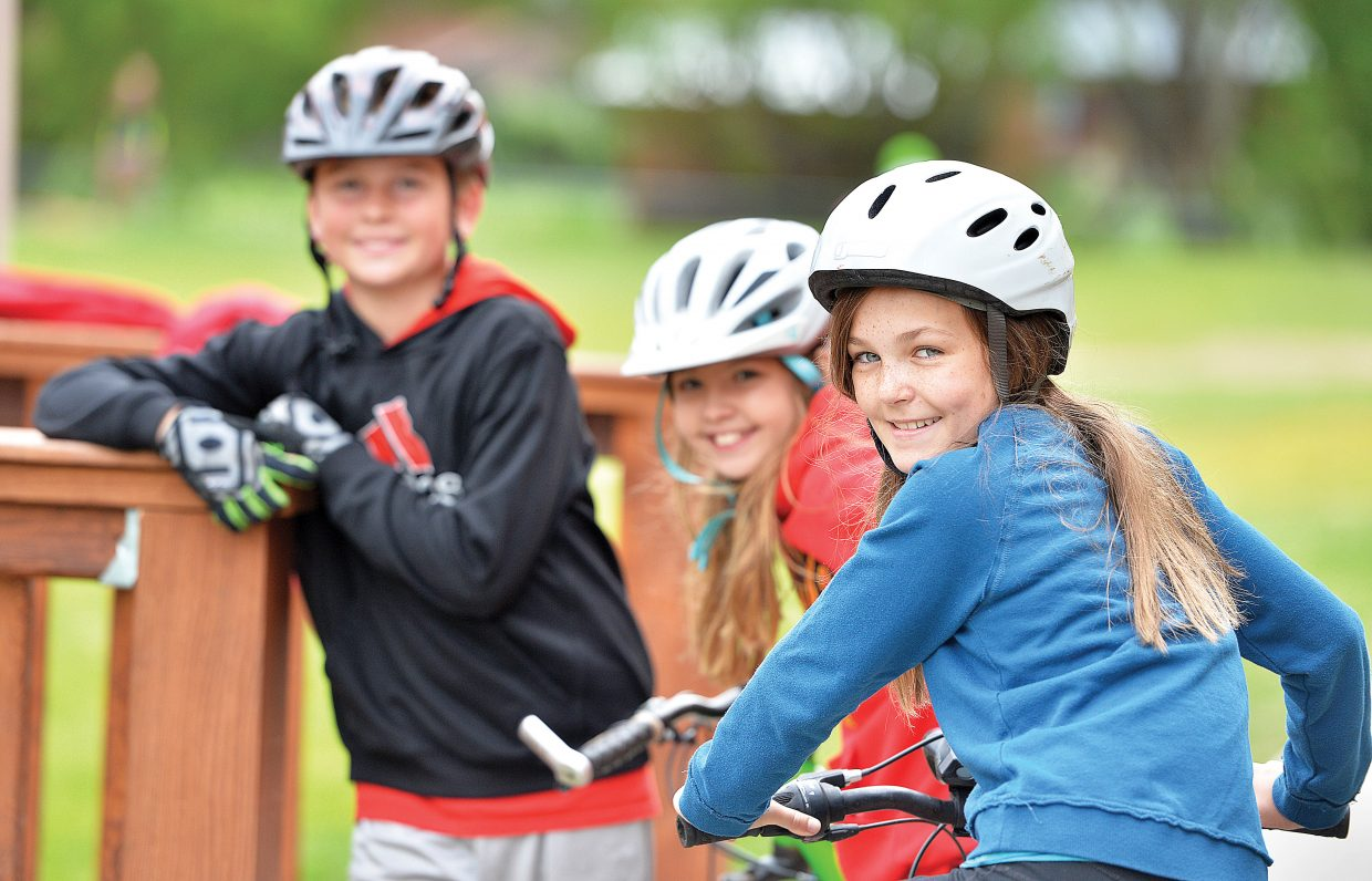 The Soda Creek Bike Rally was a chance for fifth graders Mya Boehm, front, Layne Armbruster, middle, and Charlie McCreary to get out of class and to get on their bikes Friday morning. The bike rally featured a number of different activities designed to teach young riders the proper and safe way to take to the roads.