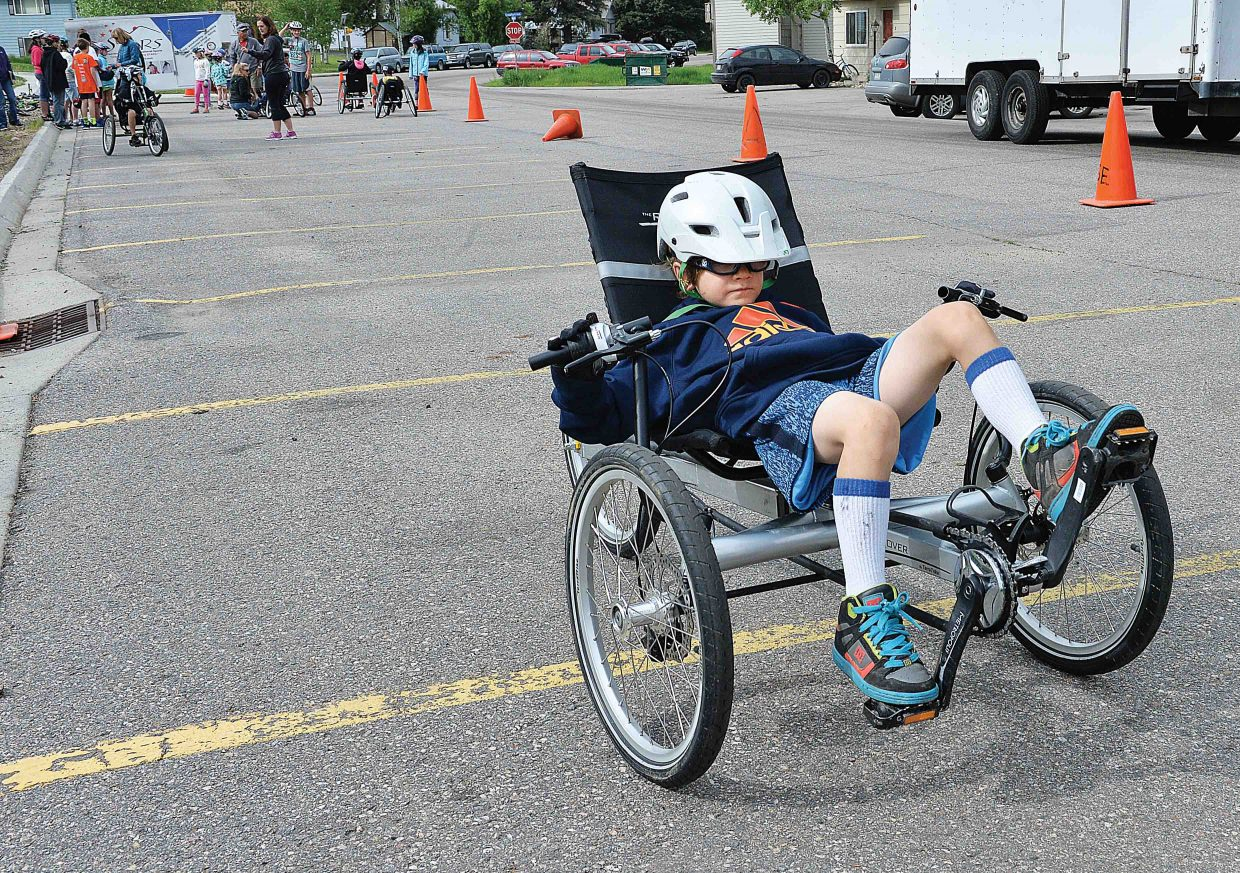 Second grader Gavin Murphy gives a recumbent bike designed for people with disabilities a go at the Soda Creek Elementary School's annual bike rally. The bike rally featured a number of different activities designed to teach young riders the proper and safe way to take to the roads. STARS was also on hand to allow the young riders to experience, things like how to ride a hand pedal bikes and how they work.
