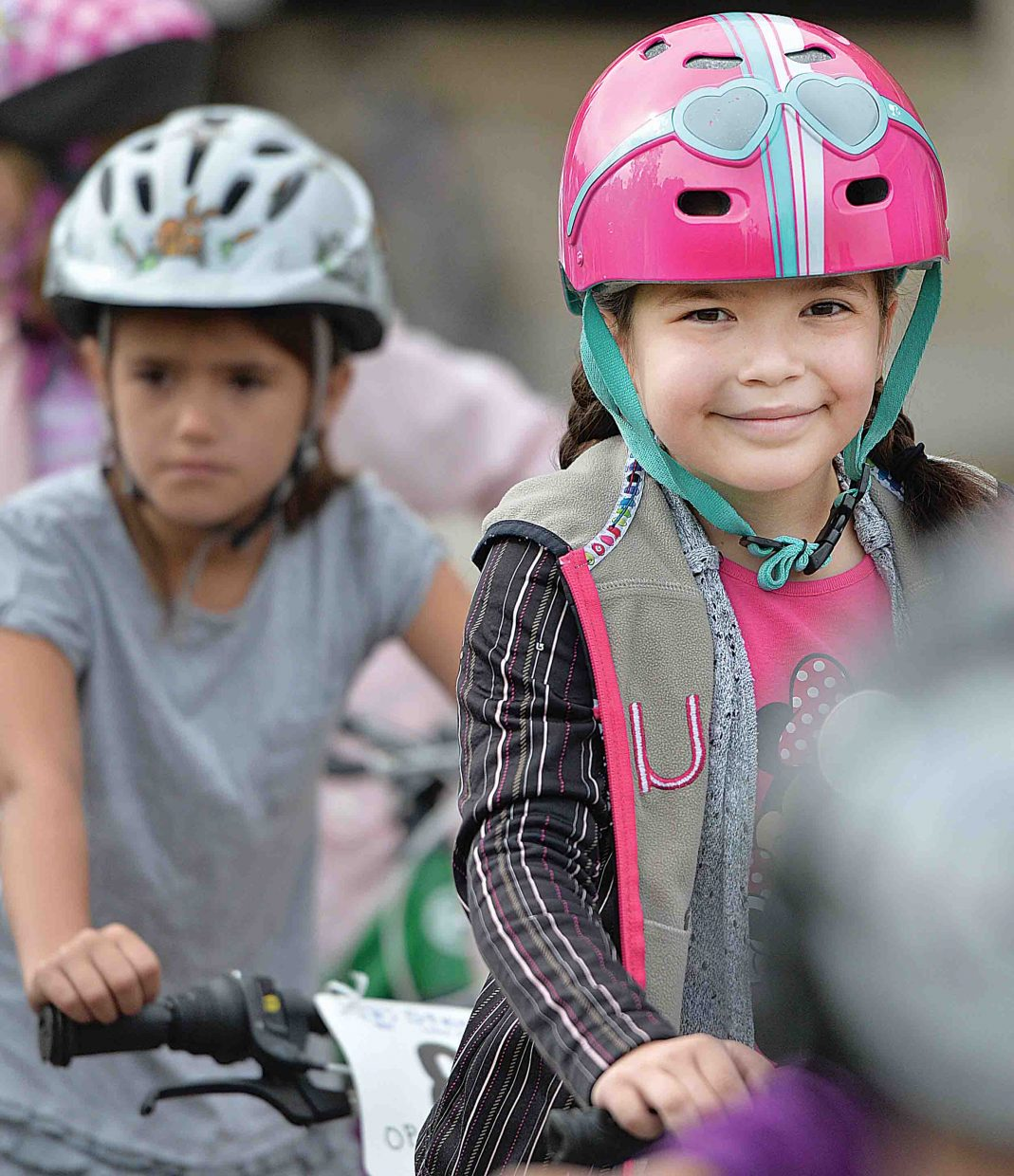 Elsa Cejudo was all smiles Friday morning as she took part in Soda Creek Elementary School's annual bike rally. The bike rally featured a number of different activities designed to teach young riders the proper and safe way to take to the roads.