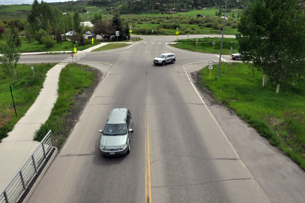 Traffic moves through the intersection of Mount Werner Road and the exit ramp of U.S. Highway 40 on Friday afternoon. The city will add stop signs to the intersection later this month so that all traffic will have to stop.