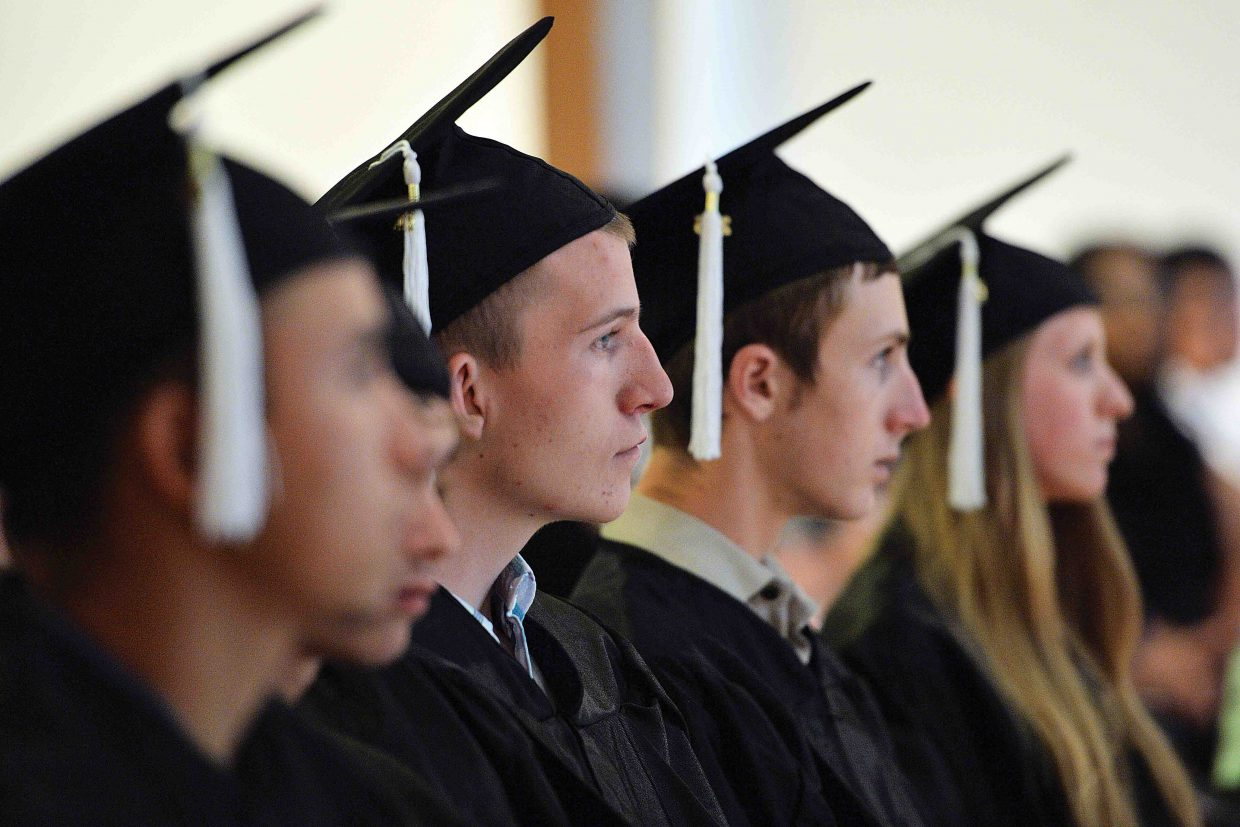 Yampa Valley High School senior Brian Riddell listens to a speaker during the school's graduation ceremony Friday afternoon at the Bud Werner Memorial Library In Steamboat Springs. The school honored six seniors as part of its annual graduation ceremony.