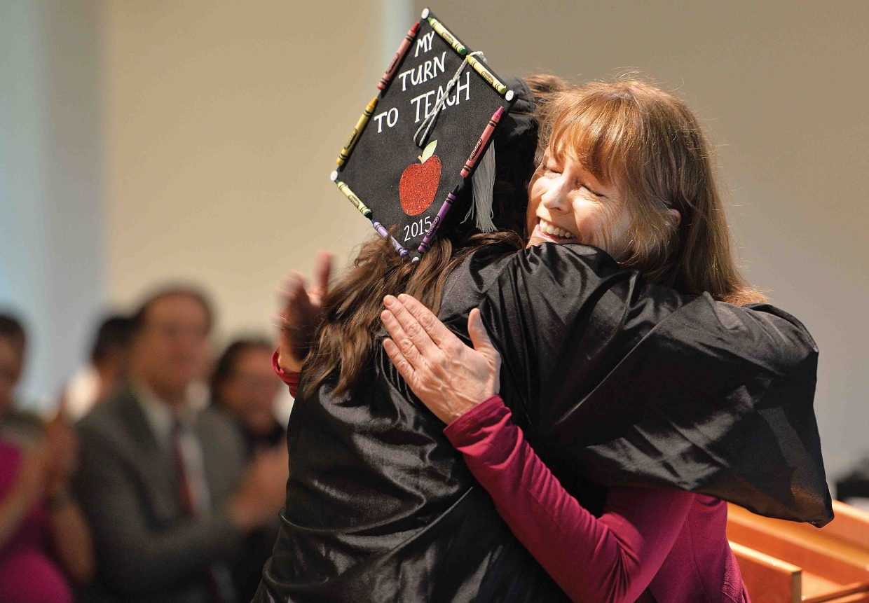Debbie Spyker hugs Amber Burns at the Yampa Valley High School's graduation ceremony Friday afternoon at the Bud Werner Memorial Library. Burns won the William P. Spyker Memorial Scholarship, which is named after Spyker's husband, William who taught at Steamboat Springs High School for 11 years.