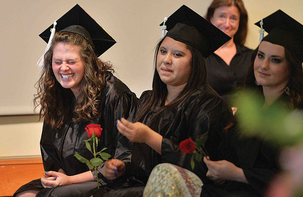 Yampa Valley High School graduating senior Amber Burns laughs between tears as a teacher recognizes her accomplishments at the school's graduation ceremony Friday afternoon at the Bud Werner Memorial Library In Steamboat Springs. The school honored eight seniors Friday as part of it's annual graduation ceremony.