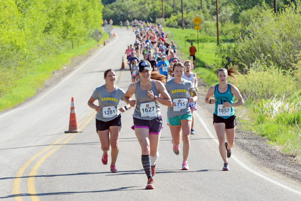 Runners in the half-marathon make their way toward Steamboat Springs Sunday on Routt County Road 129.
