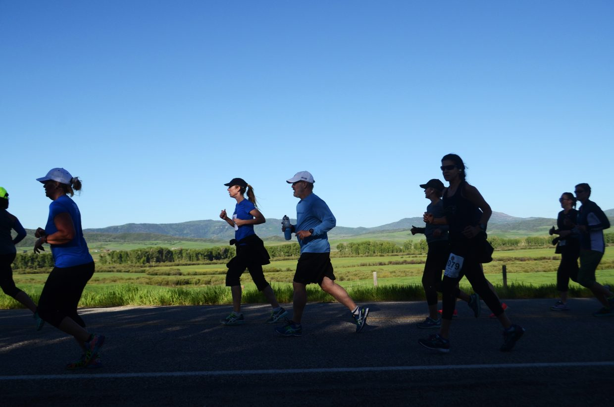 Runners in the half-marathon make their way toward Steamboat Springs on Sunday morning.