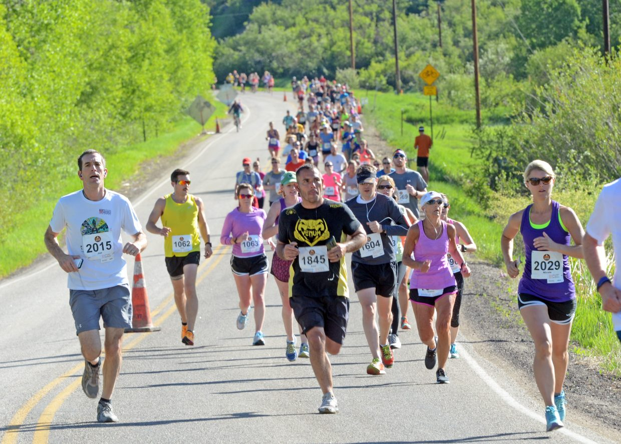 A pack of half-marathon runners makes its way toward Steamboat Springs on Sunday.