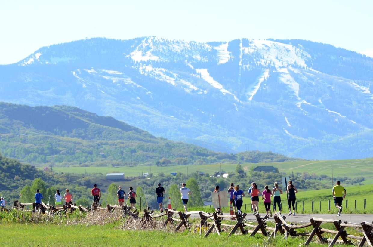 Runners in the half-marathon near the outskirts of Steamboat Springs on Sunday.