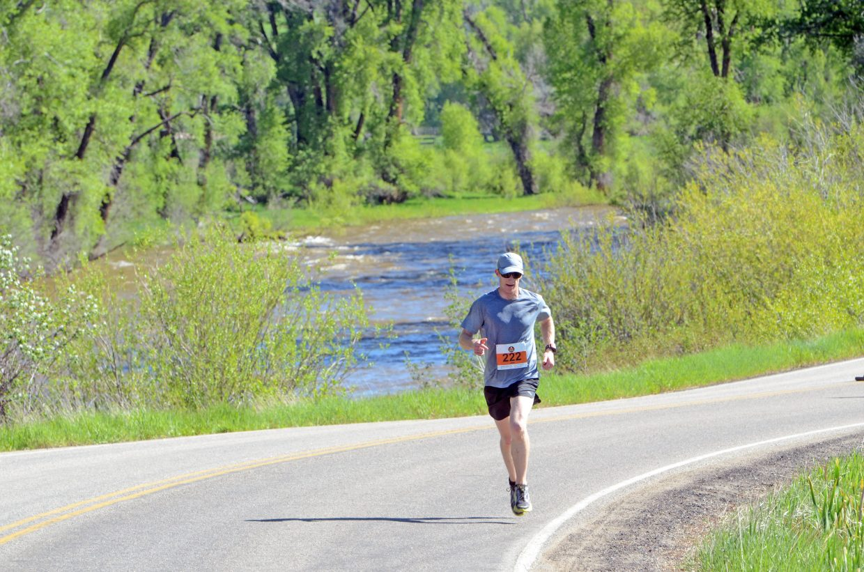 Littleton's Jim Rebenack approaches the outskirts of Steamboat Springs on Sunday during the Steamboat Marathon.