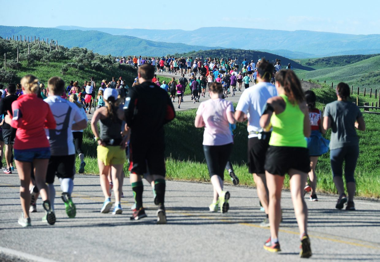 Runners in the half-marathon snake along Routt County Road 129 on Sunday.