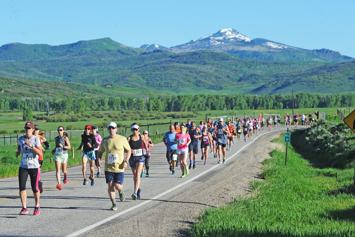 Runners in the half-marathon make their way toward Steamboat Springs on Sunday.