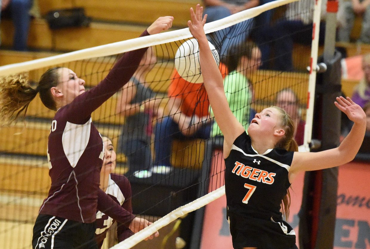 Allison Ingols goes up to tap the ball against Soroco during the volleyball season.