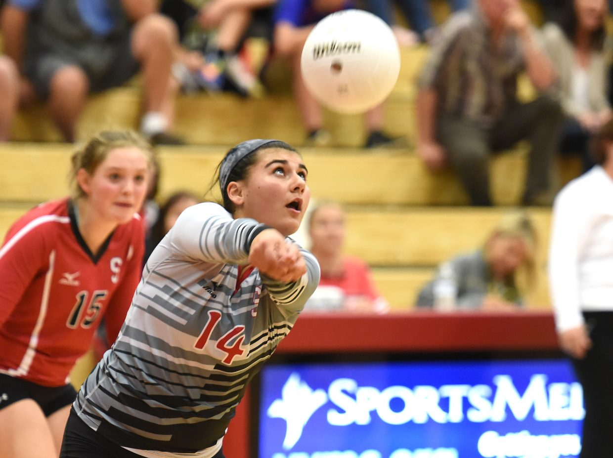 Maddie Labor lines up to receive a hit during the Sailors' league-championship volleyball season.
