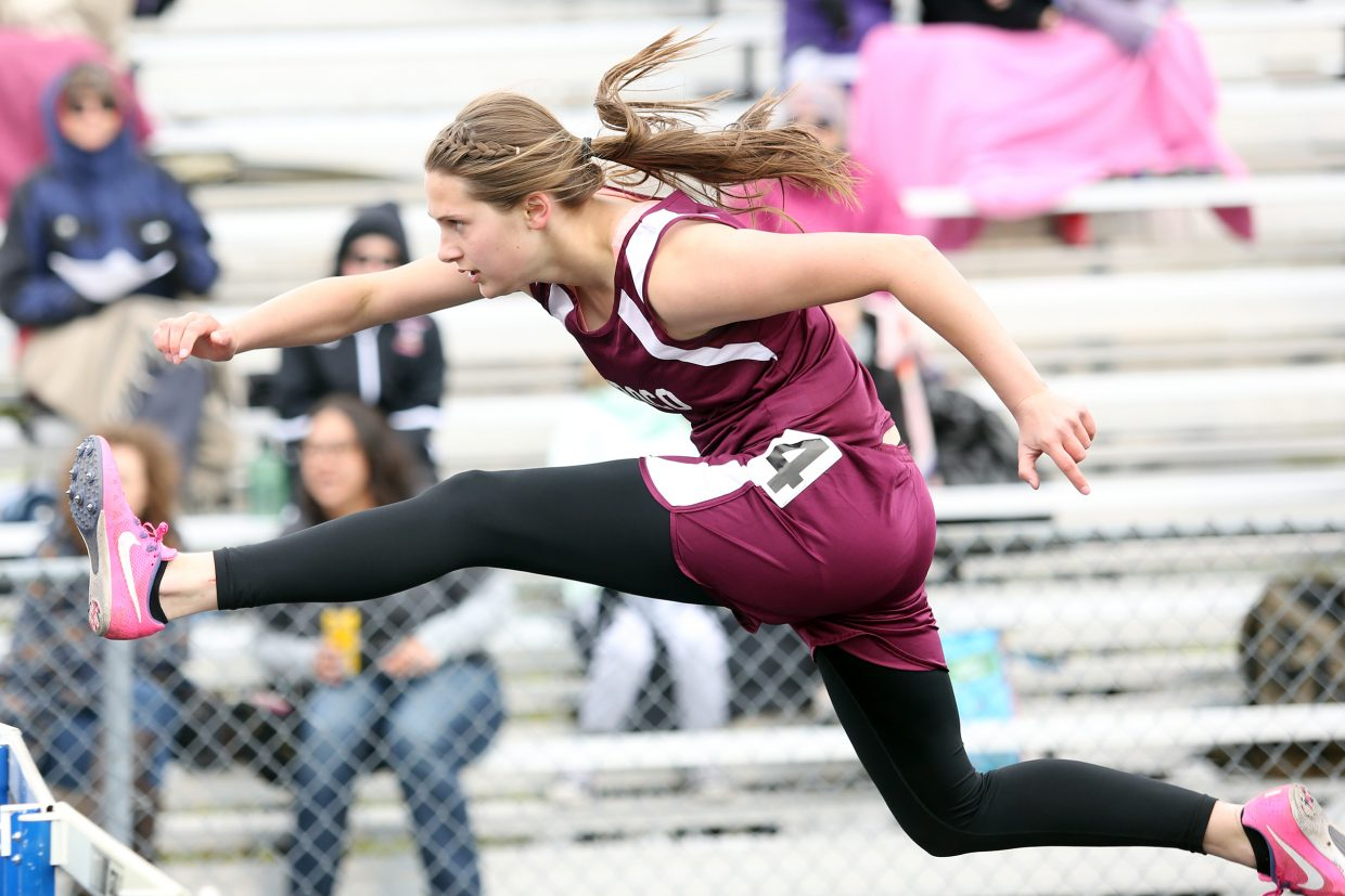 Mattie Rossi flies over a hurdle at the state track meet in Lakewood.
