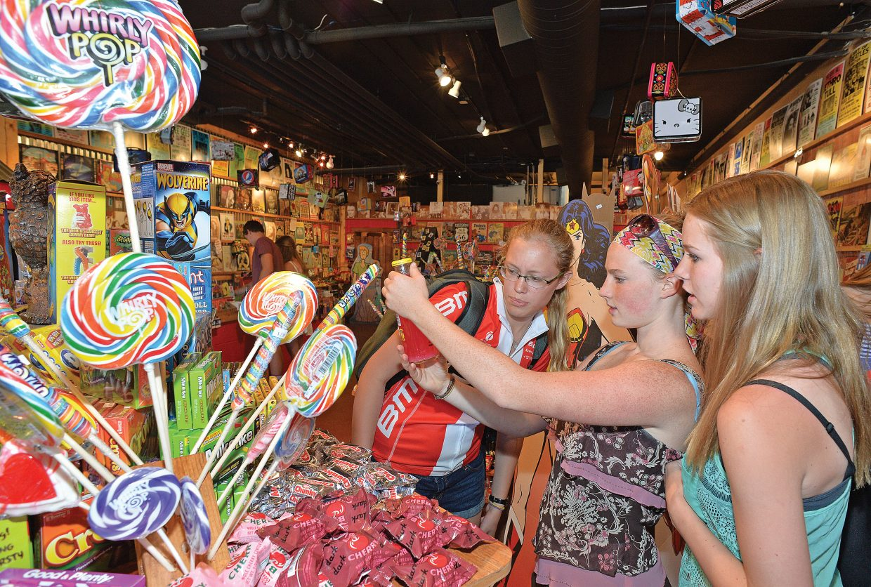 Cole Sias, Olivia Hobson and Erica Moos check out a soda at the nostalgia-heavy Rocket Fizz Soda Pop and Candy Shop has been open for about a month already, but Patrick Evans is prepping for its official grand opening celebration this weekend.