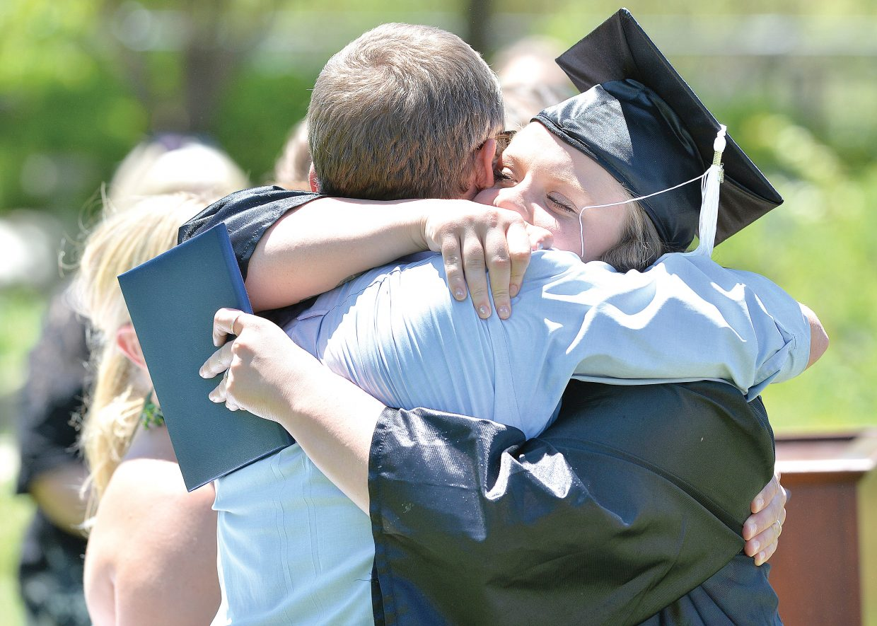 Senior Jessica Quarto-Walsh gets a hug from Yampa Valley High School lead teacher Chuck Rosemond at Friday's graduation ceremony. The Yampa Valley High School's Class of 2014 included eight graduating seniors this year.