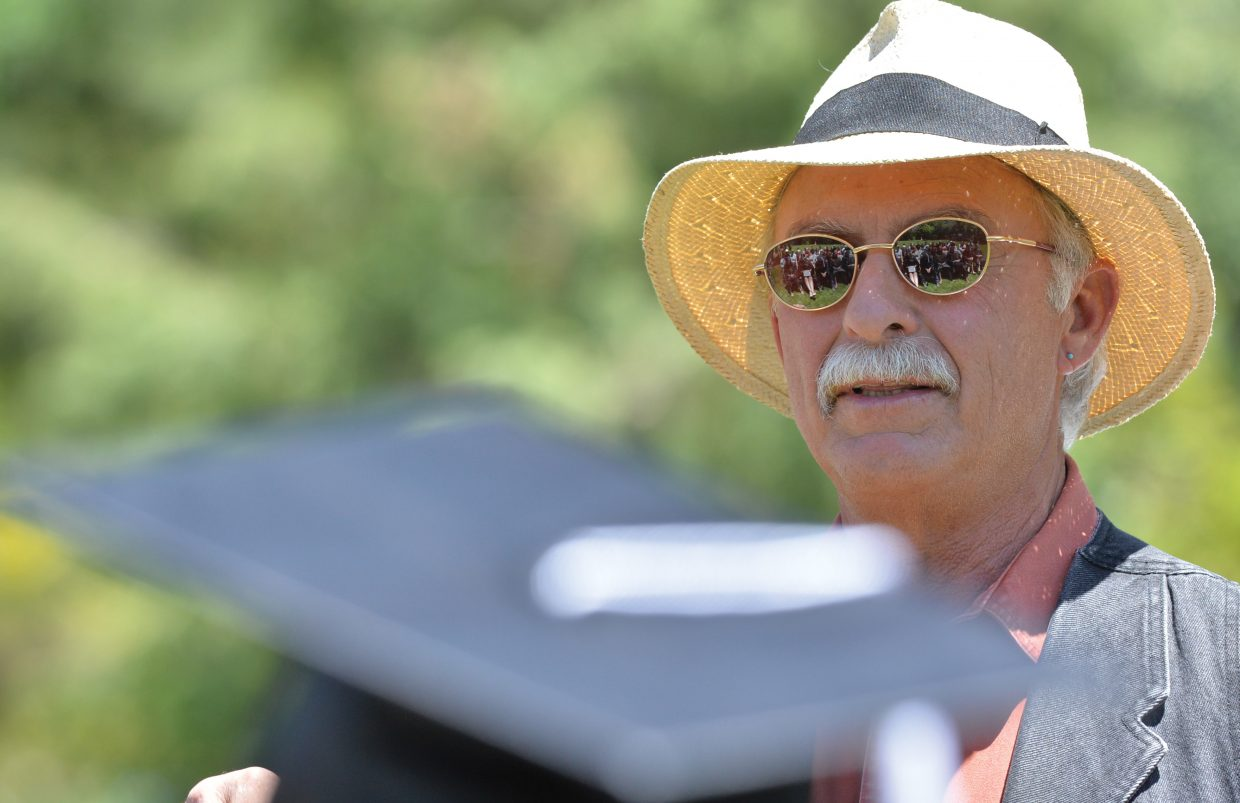 The graduating class of the Yampa Valley High School is reflected in keynote speaker Johnny Walker's sunglasses during Friday's ceremony at the Yampa River Botanic Park. This year's class included eight graduating seniors, seven of which were at Friday's graduation.