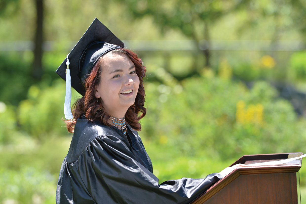 Graduating senior Teneka Worton laughs while speaking to her class at the 2014 Yampa Valley Hihg School graduation Friday at the Yampa River Bontanic Park.