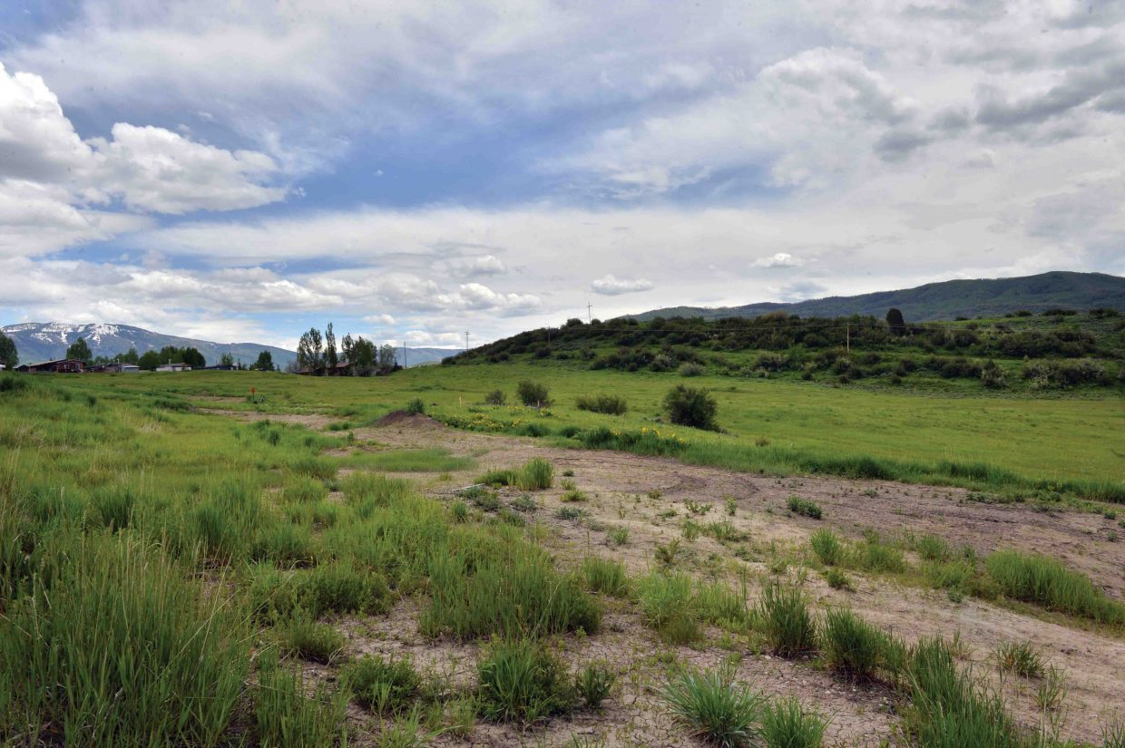 The Steamboat Springs School District is interested in negotiating the purchase of a 70-acre site owned by Yampa Valley Electric Association for the purpose of building a new high school.