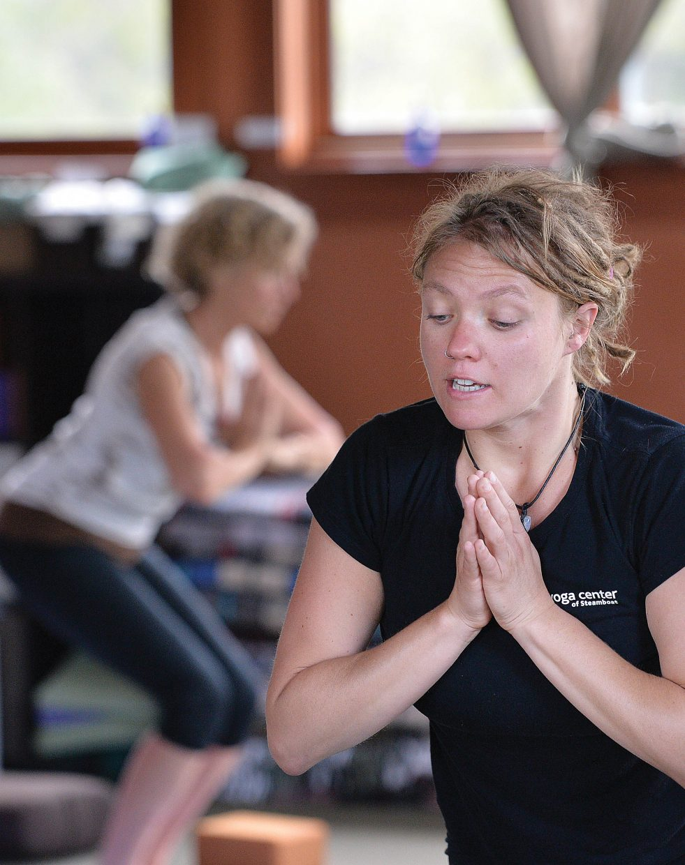 Instructor Ashley Kaszynski guides a class through a yoga session at the Yoga Center of Steamboat Springs.