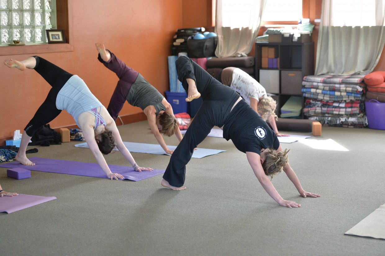 A class at the Yoga Center of Steamboat Springs takes part in a recent session inside its downtown Steamboat Springs location.