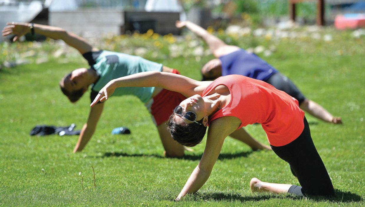 Whitney Geiger takes part in an outdoor yoga class held at the Community Garden in Steamboat Springs led by Chelsea Call and Charlie Chase.