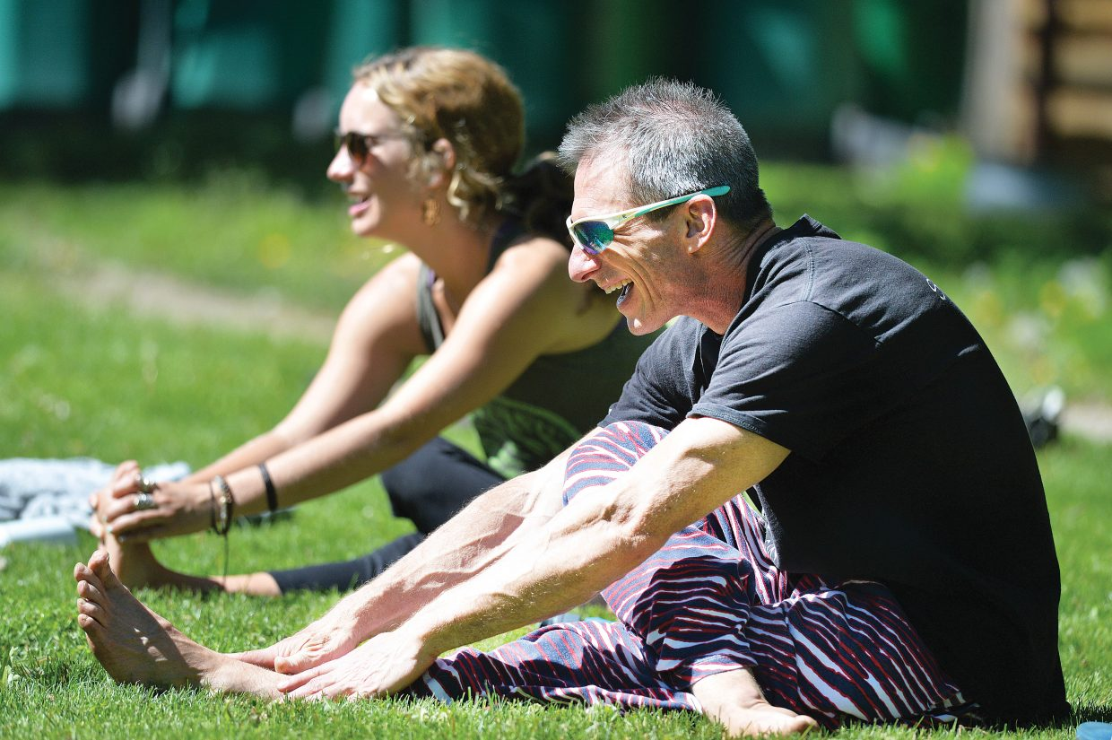 Instructors Charlie Chase and Chelsea Call take part in an outdoor yoga class. This weekend, celebrate the beginning of summer with yoga or one of Steamboat's many events.