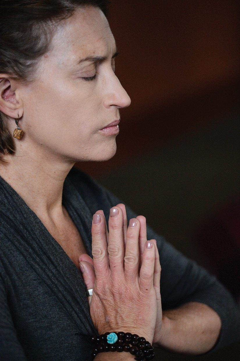 Bonnie Robertson holds her focus during a class at the Yoga Center of Steamboat Springs.
