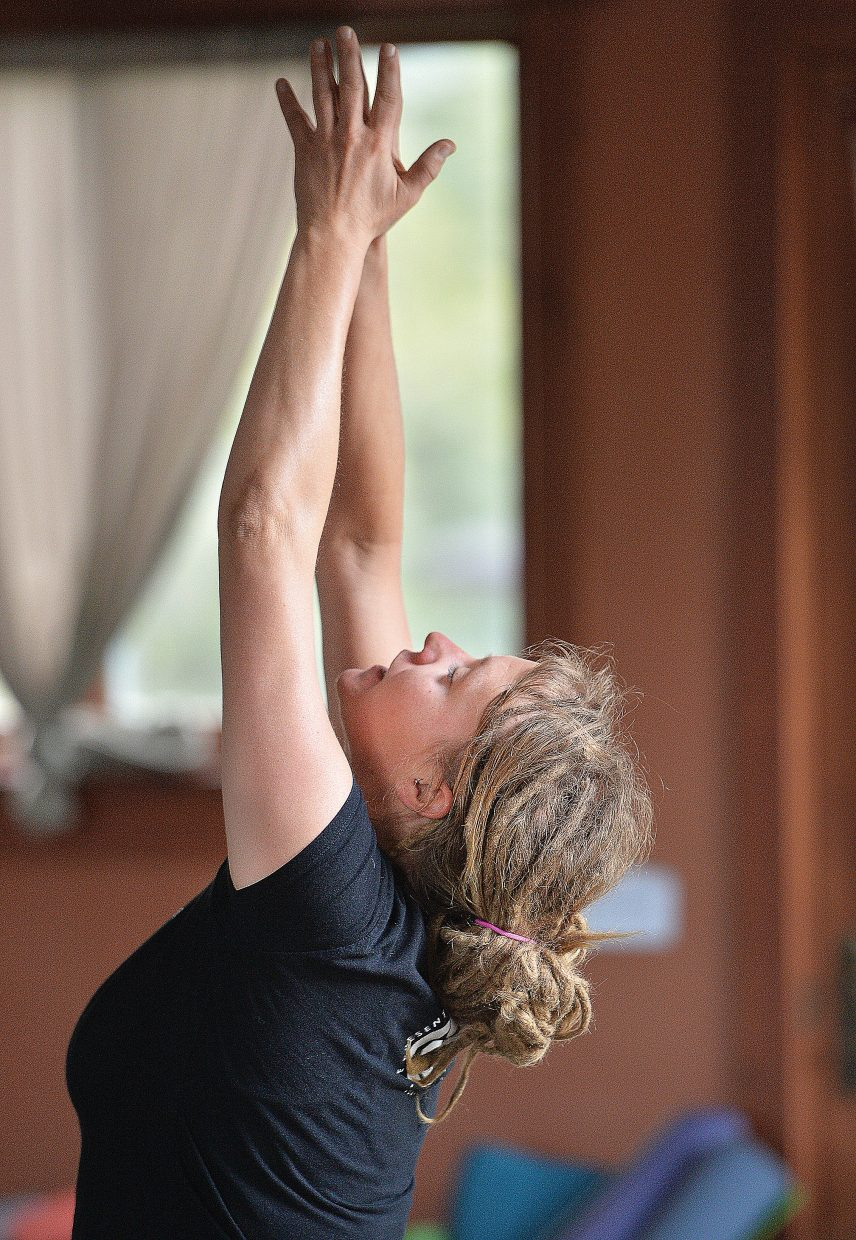 Instructor Ashley Kaszynski leads a class at the Yoga Center of Steamboat Springs.