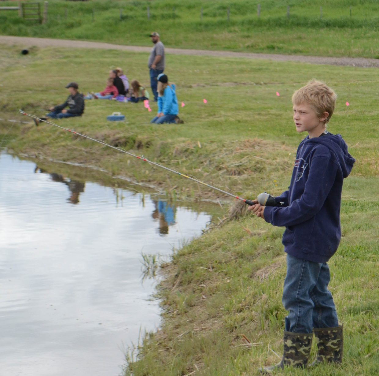 Cale Howard, of Hayden, casts his line during Saturday's Huck Finn Day Fishing Derby at Hayden's Dry Creek Park.