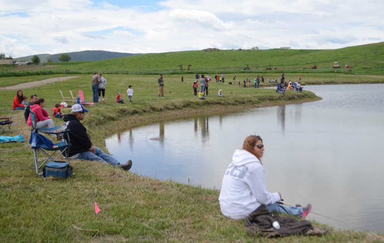 The threat of rain Saturday morning didn't stop dozens of people from participating in the Huck Finn Day Fishing Derby at Dry Creek Park in Hayden.