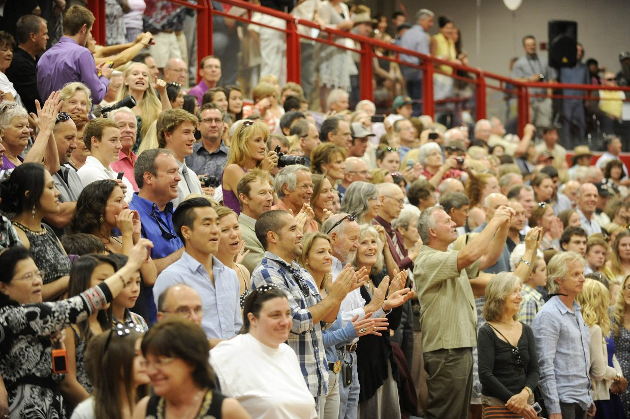 Family and friends welcome the Class of 2014 during the Steamboat Springs High School graduation ceremony Saturday.
