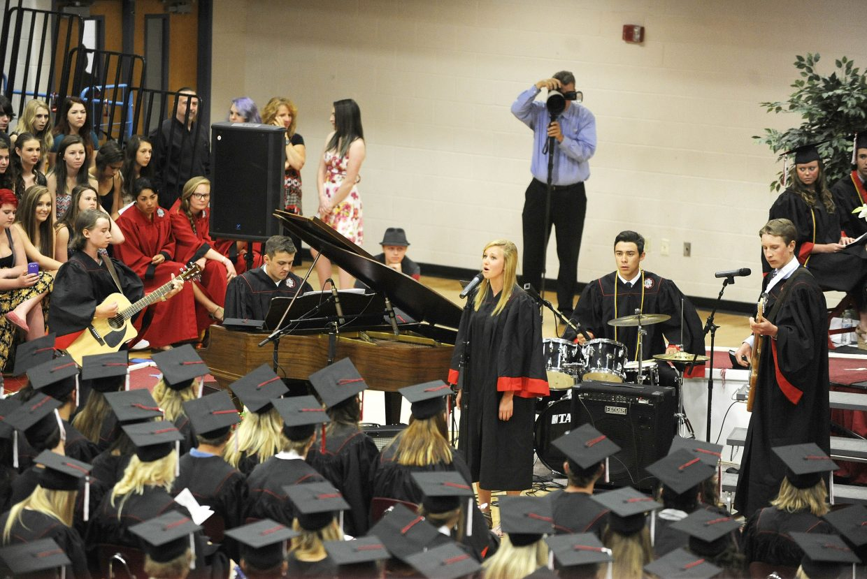 "Graduates perform ""Laughter Lines,"" during the graduation ceremony Saturday at the Steamboat Springs High School."
