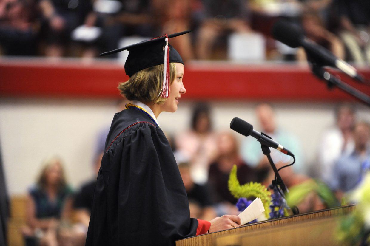 Madison Ruppel reads a poem to her classmates during the 2014 graduation ceremony.