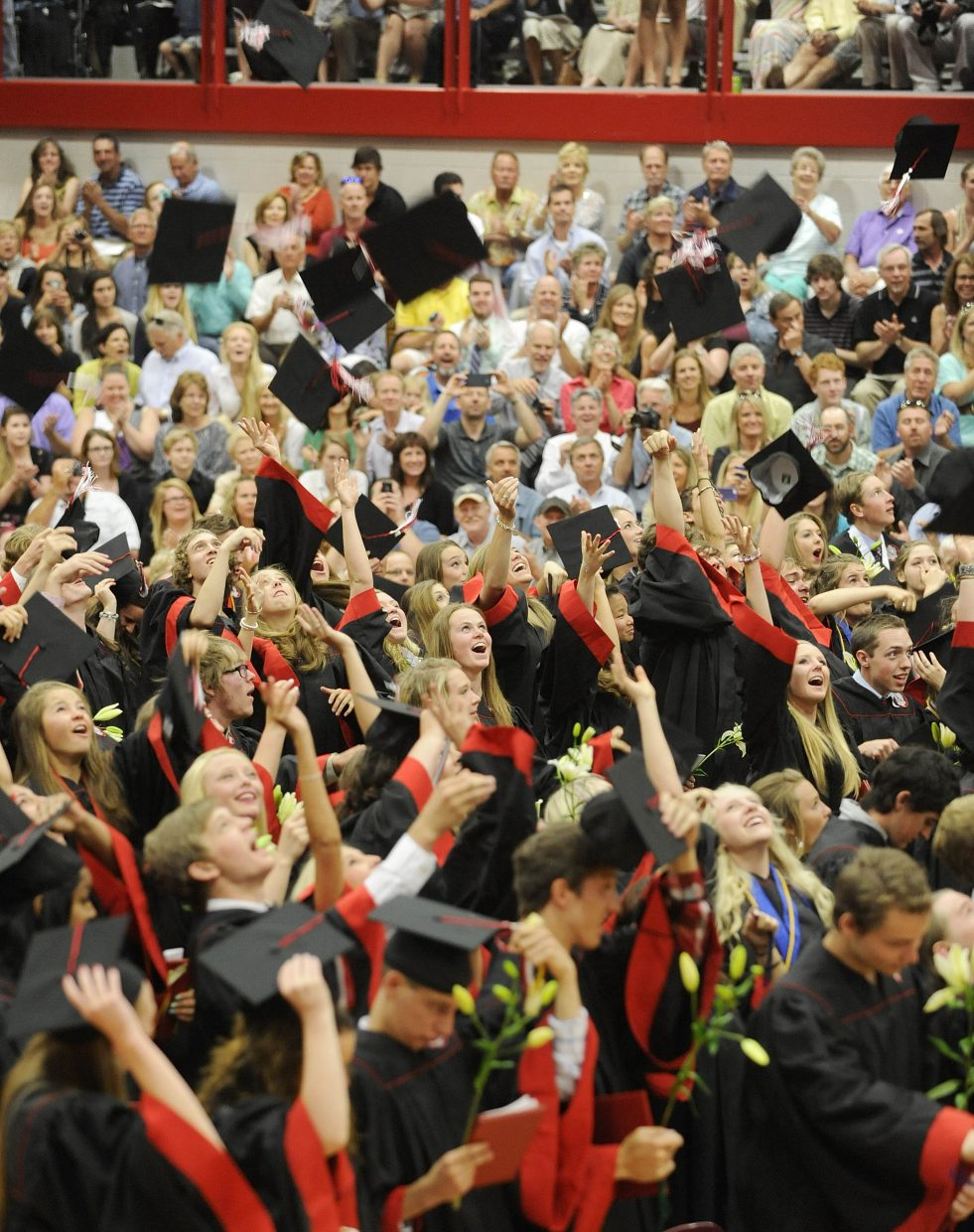 Steamboat Springs High School graduates throw their mortarboards into the air Saturday.