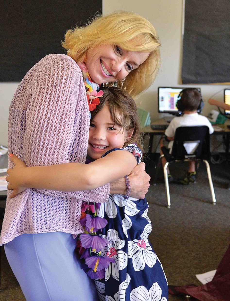 Longtime Steamboat Springs teacher Allyson Spear gets a hug from her student Cameron Romero Friday afternoon. Spear is retiring from teaching after 31 years in the Steamboat Springs school district at the end of this school year.