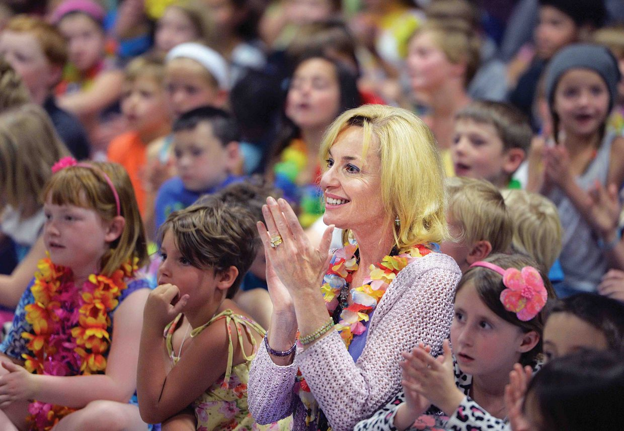 Longtime Steamboat Springs teacher Allyson Spear applauds one of the acts Friday afternoon during Strawberry Park Elementary School's talent show. Spear is retiring from teaching at the end of this school year after 31 years in the Steamboat Springs School District.