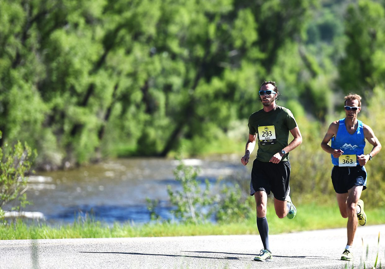 Gabe Small, left, and Andrew Biglow run Sunday during the Steamboat Marathon. Biglow finished second and Small third.