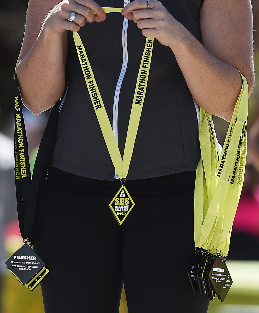 A volunteer holds medals while waiting for finishers at Sunday's Steamboat Marathon in Steamboat Springs.